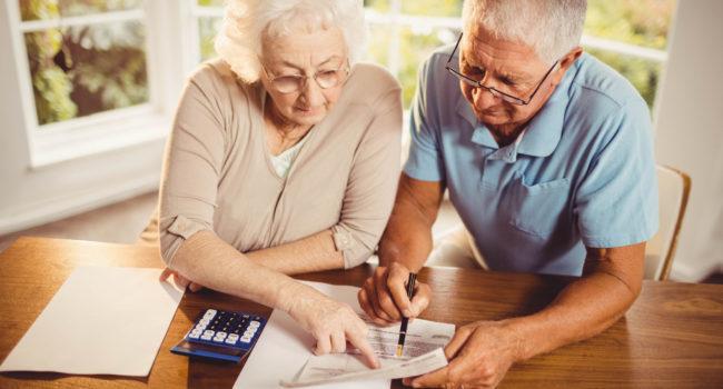 senior couple paying bills